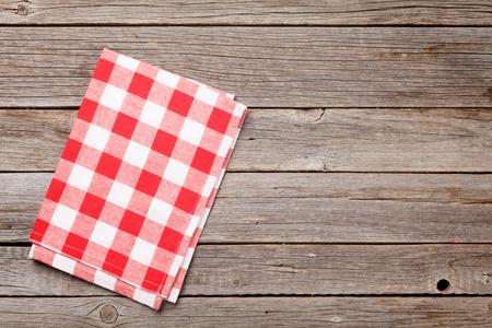 Photo pour Kitchen towel on wooden cooking table. Top view with copy space - image libre de droit