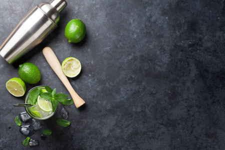 Photo pour Mojito cocktail on dark stone table. Top view with copy space for your text - image libre de droit