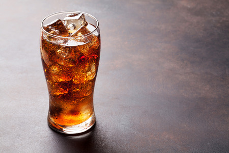 Foto de Cola glass with ice cubes with copy space - Imagen libre de derechos