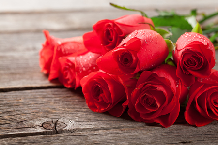 Photo for Valentines day greeting card with red roses on wooden table - Royalty Free Image