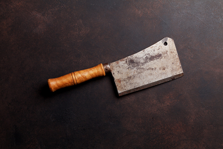 Photo for Butcher. Vintage meat knife over stone table. Top view - Royalty Free Image