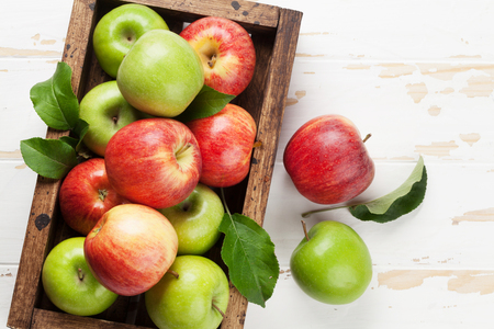 Foto für Ripe green and red apples in wooden box. Top view with space for your text - Lizenzfreies Bild