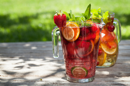 Photo pour Homemade lemonade or sangria with summer fruits and berries. Outdoor. With space for your text - image libre de droit
