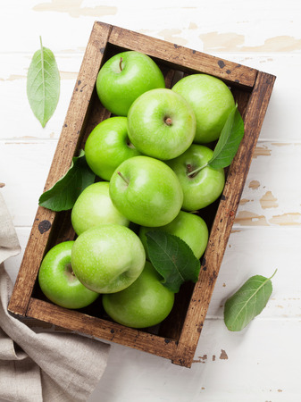 Photo for Ripe green apples in wooden box. Top view - Royalty Free Image