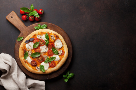 Photo for Italian pizza with tomatoes, mozzarella and basil. Top view with space for your text - Royalty Free Image