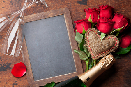Photo for Valentine's day greeting card with champagne and rose flowers on wooden background. Top view with chalkboard for your greetings - Royalty Free Image