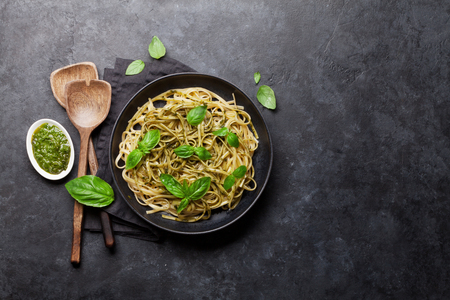 Photo pour Spaghetti pasta with pesto sauce, parmesan cheese and fresh basil. Top view with copy space for your text - image libre de droit