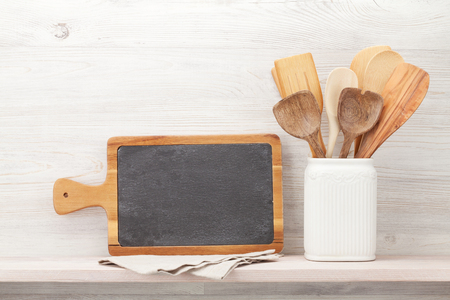 Photo pour Set of various kitchen utensils. In front of wooden wall with chalkboard for your text - image libre de droit