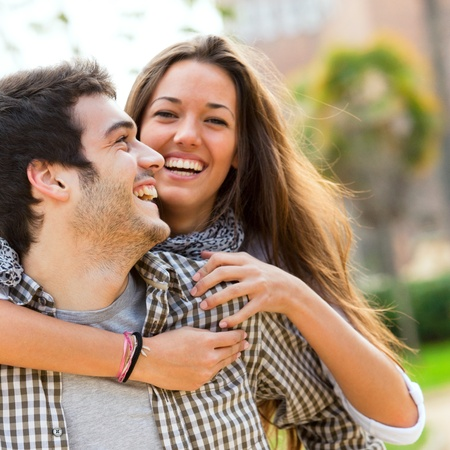 Close up portrait of happy laughing couple having fun outdoors
