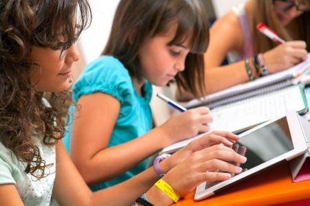 Photo for Close up of Teenage girls doing homework.  - Royalty Free Image