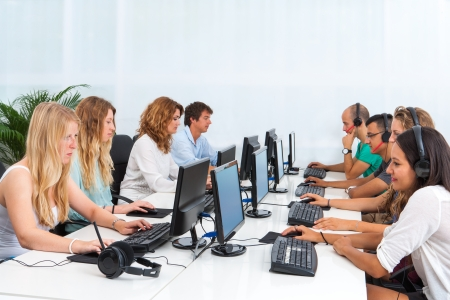Photo for Group of young students doing training course on computers. - Royalty Free Image