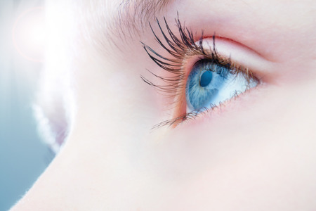 Photo for Macro close up of human eye with bright light in background. - Royalty Free Image