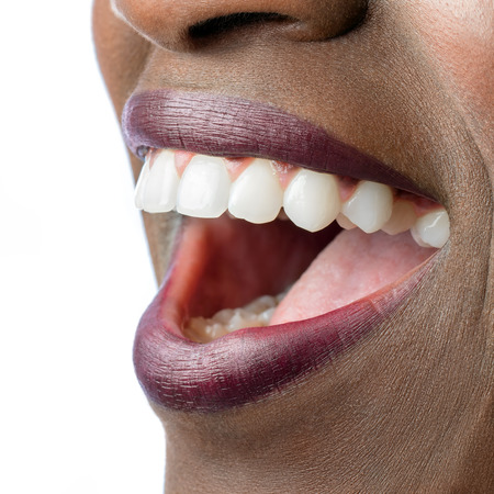 Photo for Macro close up of African female mouth. Open mouth showing perfect white teeth isolated on white background. - Royalty Free Image