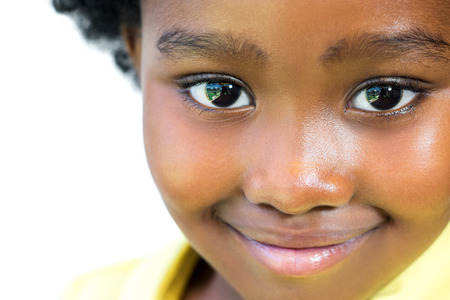 Foto de Extreme close up face shot of beautiful little african girl isolated on white background. - Imagen libre de derechos