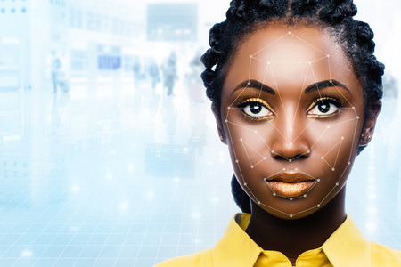 Photo for Close up portrait of attractive african woman with facial recognition technology. Grid with reference areas marked on face. Young girl against out of focus airport background. - Royalty Free Image
