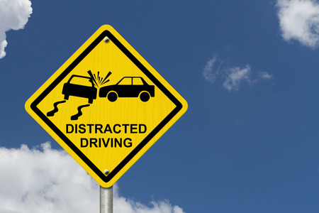 Photo for No Distracted Driving Sign, Yellow warning sign with words Distracted Driving and accident icon with sky background - Royalty Free Image