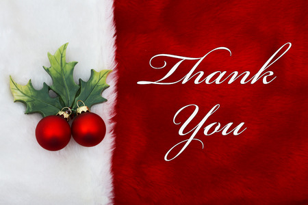 Foto für Thank You, A plush red stocking with a Mistletoe Ornament and words Thank You - Lizenzfreies Bild