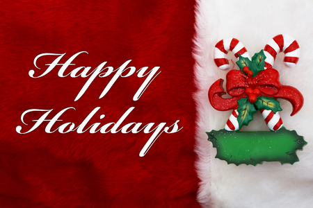 Photo for Happy Holidays, A plush red stocking with Candy Canes and words Happy Holidays - Royalty Free Image