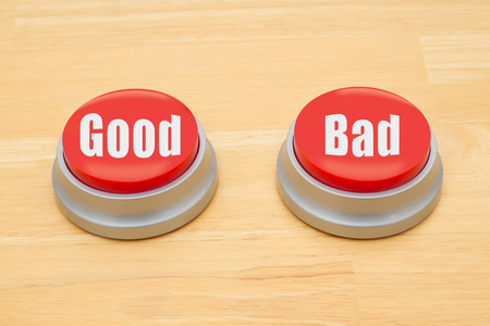 Photo pour Two red and silver push button on a wooden desk with text Good and Bad - image libre de droit