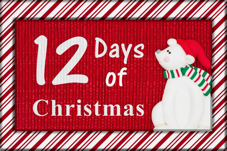 Photo for Red shiny fabric with a candy cane border and a Santa polar bear with text 12 Days of Christmas - Royalty Free Image