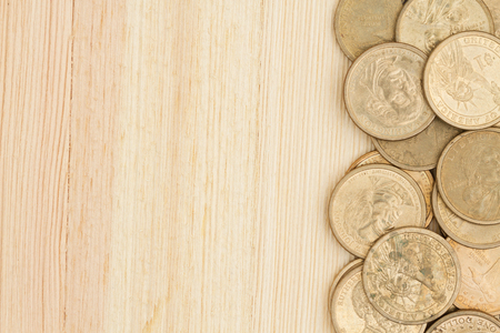 Photo pour Gold coin money background, USA gold one dollar coins on a wood desk with copy space - image libre de droit
