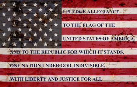 Photo for The pledge of allegiance written on a weathered United States of America flag - Royalty Free Image