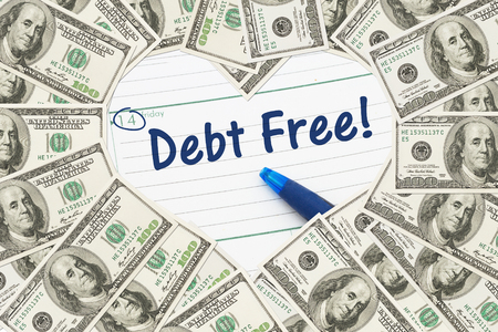 Foto de Love being debt free, One hundred dollar bill in the shape of a heart with a calendar and text Debt Free - Imagen libre de derechos