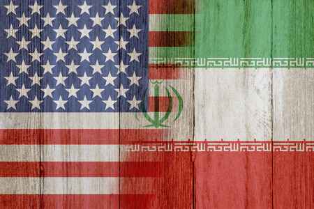 Photo pour Relationship between the USA and Iran, The flags of USA and Iran merged on weathered wood - image libre de droit