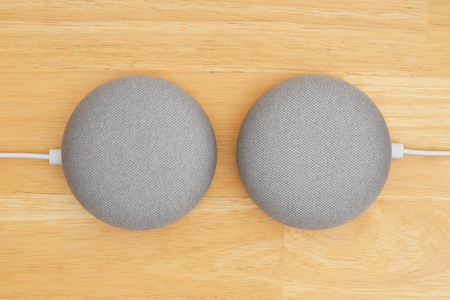 Photo for South Carolina, USA Oct 2018. Illustrative editorial image of two Google home devices on a wood desk - Royalty Free Image