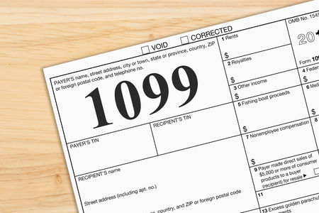 Foto per A US Federal tax 1099 income tax form on a desk - Immagine Royalty Free