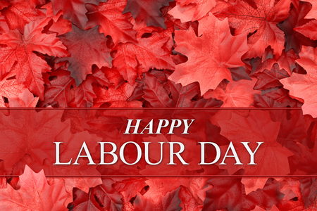Photo pour Happy Labour Day greeting with red fall leaves with Canadian and UK spelling - image libre de droit