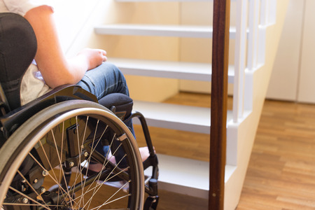 Foto de Young person in a wheelchair in front of a stair - Imagen libre de derechos