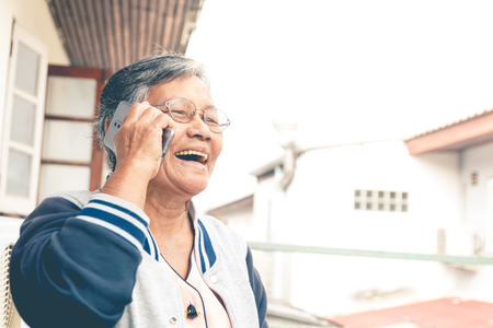 Photo for close up old asian woman with glassed use smartphone - Royalty Free Image
