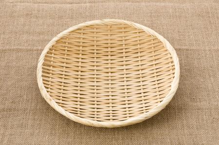 Photo pour bamboo Sieve on Burlap background - image libre de droit