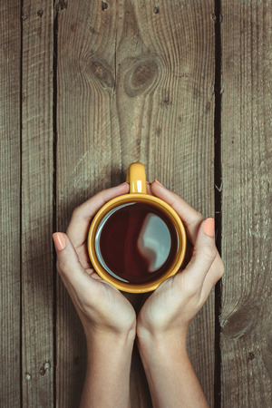 Photo for Female Hands Holding Cup Of Coffee - Royalty Free Image