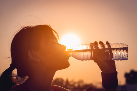 Photo for Female drinking a bottle of water - Royalty Free Image