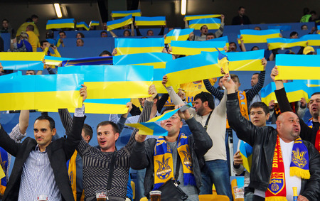 LVIV, UKRAINE - OCTOBER 12, 2014: Ukrainian fans support their team during the UEFA EURO 2016 Qualifying game between Ukraine and Macedonia on Lviv Arena