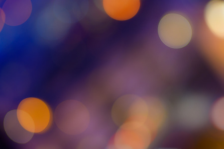 Photo pour Abstract bokeh background. Defocused colored circles on a blue background. Place for text, copyspace. Out of focus blur.  - image libre de droit