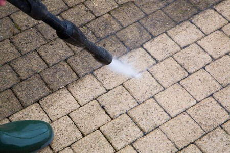 Foto per Outdoor floor cleaning with high pressure water jet - Immagine Royalty Free