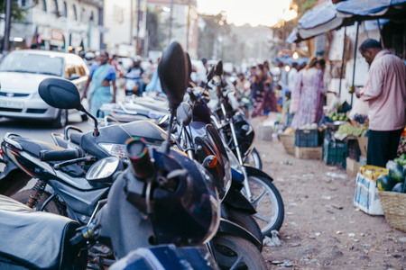 Foto per motorcycles near the market - Immagine Royalty Free