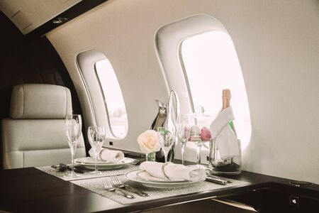Photo pour Modern and comfortable interior of business jet aircraft with decor - image libre de droit