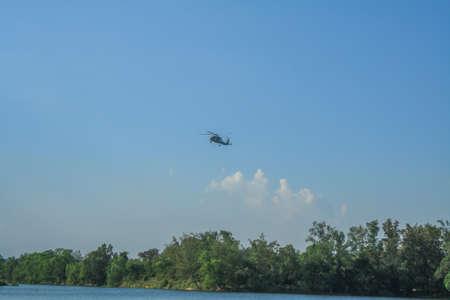Foto de Rayong/Thailand- November 21, 2018: Sikorsky S-70B-7 Seahawk Royal Thai Navy over the tree at U-Tapao Rayong International Airport, Rayong,Thailand - Imagen libre de derechos