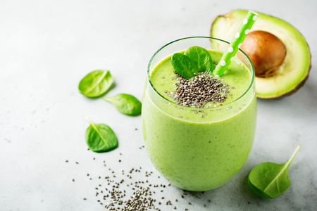 Photo for Vegetarian healthy green smoothie from avocado, spinach leaves, apple and chia seeds on gray concrete background. Selective focus. Space for text. - Royalty Free Image