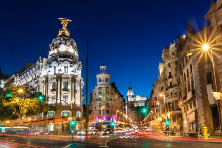 Photo for Rays of traffic lights on Gran via street, main shopping street in Madrid at night. Spain, Europe. - Royalty Free Image