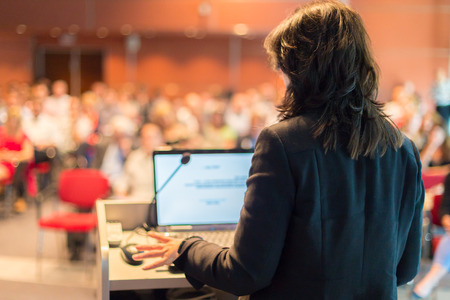 Photo pour Business woman lecturing at Conference  Audience at the lecture hall  - image libre de droit
