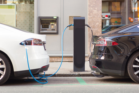 Foto de Power supply for electric car charging.  Electric car charging station. - Imagen libre de derechos