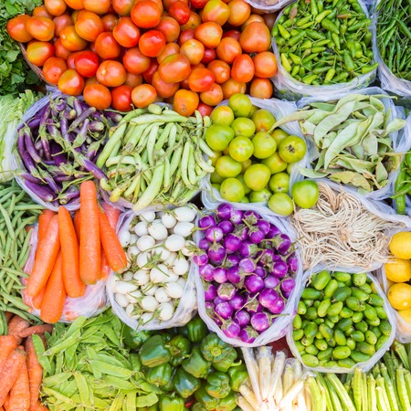 Farmers market with various domestic colorful fresh fruits and vegetable. Tasty colorful mix. Square composition.