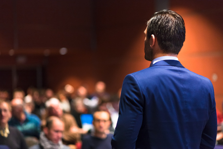 Photo for Speaker giving a talk on corporate Business Conference. Audience at the conference hall. Business and Entrepreneurship event. - Royalty Free Image