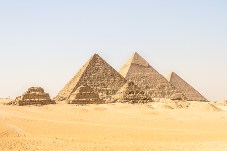 Photo pour Giza pyramids in Cairo, Egypt. General view of pyramids from the Giza Plateau Three pyramids known as Queens Pyramids on front side. Next in order from left, the Pyramid of Menkaure, Khafre and Chufu - image libre de droit