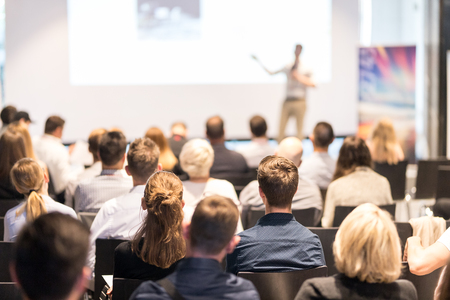 Photo for Speaker giving a talk in conference hall at business event. Audience at the conference hall. Business and Entrepreneurship concept. Focus on unrecognizable people in audience. - Royalty Free Image